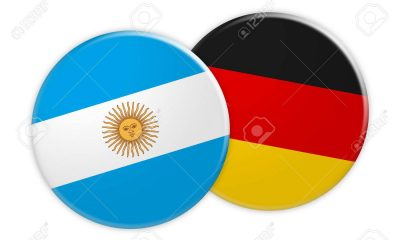 News Concept: Argentina Flag Button On Germany Flag Button, 3d illustration on white background